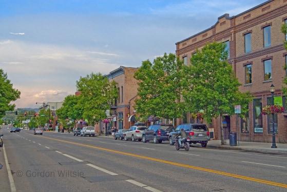 A motorcycle drives down Main Street in Bozeman, Montana.